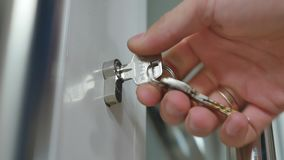 Locking up or unlocking door with key in hand.  stock footage
