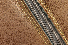Locking zipper on the leather surface Stock Photo