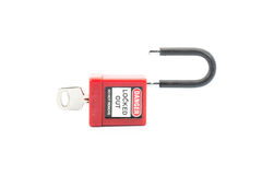 Lockout Padlock red color with key on isolated background Royalty Free Stock Images
