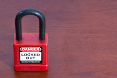 Lockout Padlock red color on wood background Stock Photo