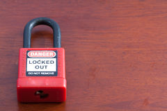 Lockout Padlock red color on wood background Royalty Free Stock Photo