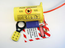 Lockout tagout. Electrical extension cord protected by lockout tagout Royalty Free Stock Images