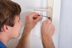 Lockpicker Fixing Door Handle At Home Royalty Free Stock Photo