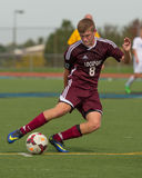 Lockport High School Soccer Player. Dribbles the soccer ball forward Royalty Free Stock Photography