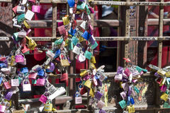 Locks. Attached to the railings at Juliet`s house in Verona Italy with messages of love between couples Royalty Free Stock Photos
