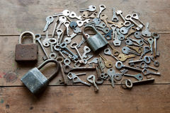 Locks And Keys On Wooden Table Stock Photography