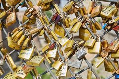 The locks are attached to the bridge. Wedding tradition. A lot of Golden locks stock photos