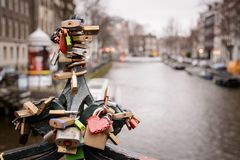 Locks on a balustrade bridge over a canal in Amsterdam Netherlands. March, 2015. Landscape format royalty free stock photography