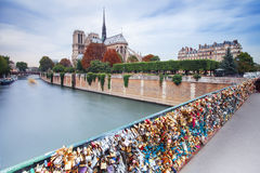 Locks on bridge near Notre Dame de Paris Stock Photos
