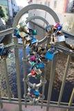Locks on bridge in Prague to symbolize love forever. PRAGUE, CZECH REPUBLIC - DECEMBER 3, 2016: Lots of love locks on small pedestrian bridge in the Mala Strana stock photo