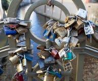 Locks on bridge in Prague to symbolize love forever. PRAGUE, CZECH REPUBLIC - DECEMBER 3, 2016: Lots of love locks on small pedestrian bridge in the Mala Strana royalty free stock image