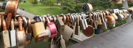 Locks on a bridge railing in Ottawa symbolizing love Royalty Free Stock Photography