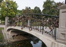 Locks on the bridge - a symbol of eternal love. Stock Photography
