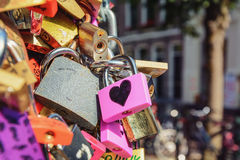 Locks on the bridge a symbol of eternal love. Royalty Free Stock Images