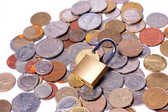 Locks and coins Stock Image