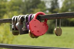 Locks in the form of heart. On the railing of the bridge Stock Photos