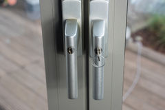 Locks at glass doors to the garden as defense for break-in Royalty Free Stock Image