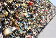 Locks. Golden locks with wishes locked for love on a bridge behind Notre Dame in Paris royalty free stock image