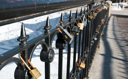 Locks on handrail Royalty Free Stock Images
