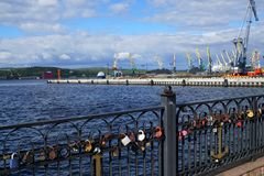 Locks at the handrail in the port for happy family life. royalty free stock images