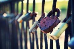 Ukraine, Kiev. Locks hang on the fence. Locks hang on the fence. Many old locks hang on the fence stock photo