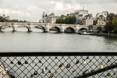 Locks that hang on the railing on the bridge over the Seine. In Paris Stock Images