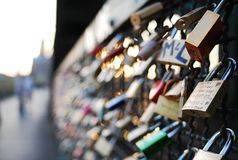 Locks on Kolen bridge. With Kolon Dom Royalty Free Stock Photos