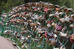Locks of love. Wedding locks of love on bridge handrails in Russian town of Vologda stock photos