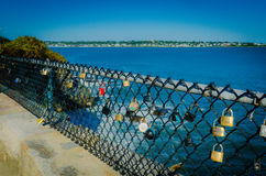 Cliff Walk - Newport RI - Locks of Love. Locks fastened on chain link fence signal endless love along Cliff Walk in Newport, RI Stock Photography