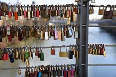 Locks love and secrets. Locks in a bridge in Bamberg Germany represent the love and secrets of couples Stock Photo