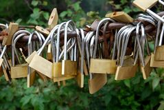 Locks of love - symbol for everlasting friendship. Padlocks lined up in promise eternal love in front of the mountain Huangshan, The keys are thrown into the royalty free stock photography