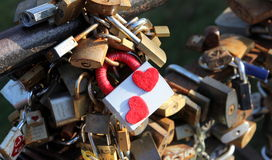 Locks of love. Tradition on weddings to put lock on the bridge. A love lock or love padlock is a padlock which sweethearts lock to a bridge, fence, gate, or royalty free stock photo