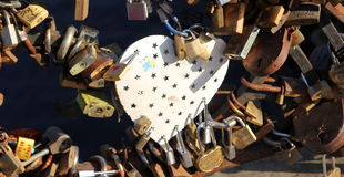 Locks of love. Tradition on weddings to put lock on the bridge. A love lock or love padlock is a padlock which sweethearts lock to a bridge, fence, gate, or stock images