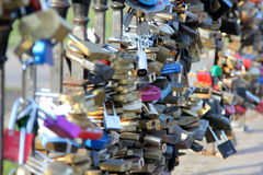 Locks of love. Tradition on weddings to put lock on the bridge. A love lock or love padlock is a padlock which sweethearts lock to a bridge, fence, gate, or royalty free stock photography