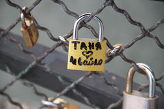 Locks with lovers names at river pont Stock Photography