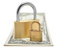 Locks on Money. Two golden locks sitting on top of a stack of money. Can signify the Dad and son lock or Big Security Mixed with little security stock image