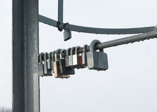 Locks mounted. Locks hanging suspended from a metal rod on the pedestrian bridge Stock Image