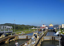 Through the Locks, Panama Canal. Two Boats moving through a set of locks in the Panama Canal, a major waterway linking the Atlantic and Pacific oceans stock photography