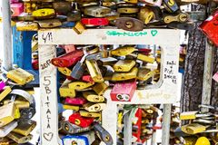 Locks of people in love on a street fence in the center of the city,. BUDAPEST, HUNGARY - 22 AUGUST 2017:Locks of people in love on a street fence in the center Stock Images
