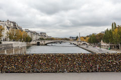 Locks on the Pont de l'Archeveche bridge next to the Notre Dame de Paris cathedral in Paris Stock Photo
