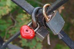 Locks on the railing of the bridge Stock Photography