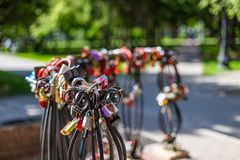 Locks on rails symbolize eternal love and loyalty, Russia.  royalty free stock image
