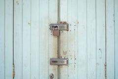 Locks on rusty wooden door.Nobody`s home concept. Stock Image