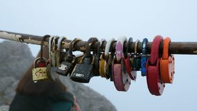 Locks in the shape of a heart hang on the bar. stock footage