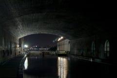 Locks Under Bridge at Night Stock Photo
