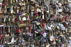 Locks on wedding bridge photo. Stock Images