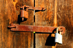 Locks on wooden door Stock Images