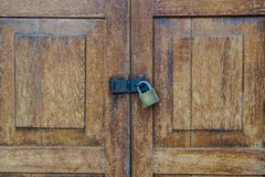Lockset on the door wooden pattern textured background. Stock Image
