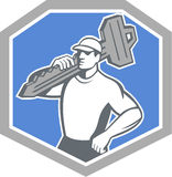Locksmith Carry Key Shield Retro. Illustration of a locksmith standing front side view carrying key on shoulder set inside shield  crest on isolated background Stock Image