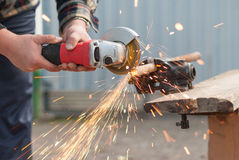 Locksmith cut the metal. Stock Photo
